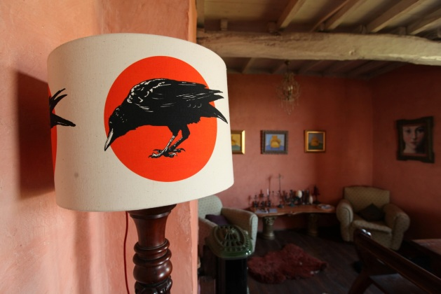 Curious Corvus at home in French dining room